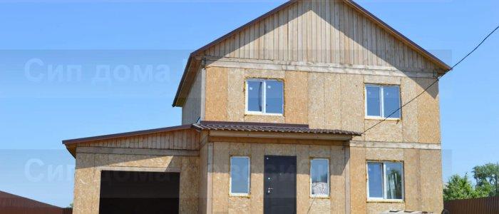 Фото реального дома по проекту 11. Недорогой, быстровозводимый каркасный дом из СИП панелей с гаражом, г. Новосибирск