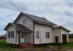 Фото готового недорогого, каркасного дома из СИП панелей под ключ с гаражом по проекту №10, 152 м2 (Новосибирск, Томск, Барнаул, Алтай, Новокузнецк)